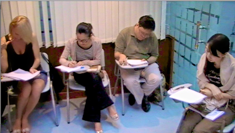students doing grammar exercise in class